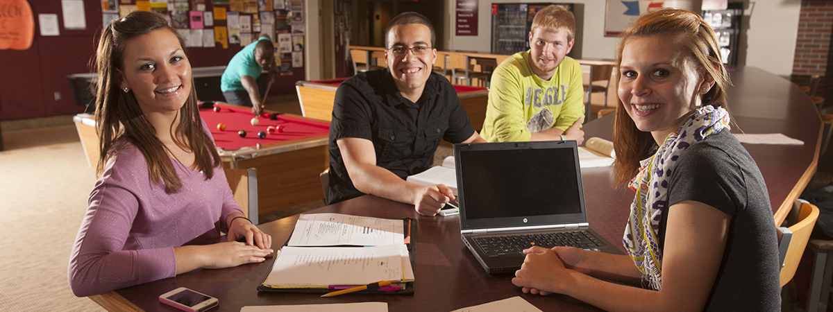 Students in Sargeant Student Center working together on a project.