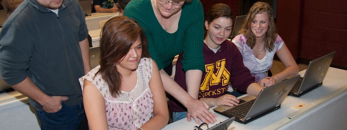 Margo Rudstrom, UMC faculty, working with several students during class.