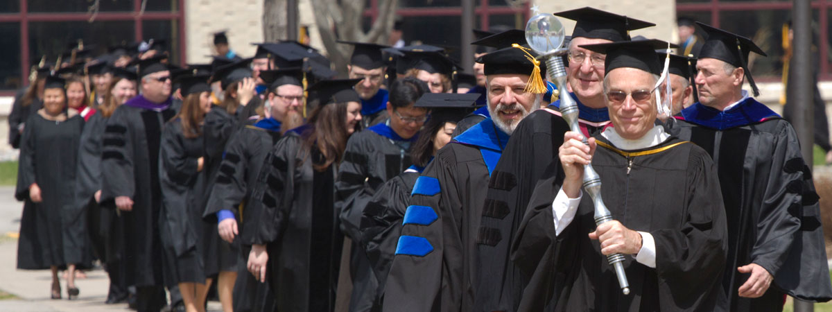 2015 Commencement walking to the Sport Center