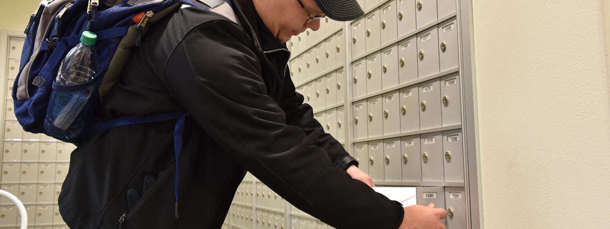 A student checking his mail