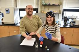 Catie Brown and instructor in lab