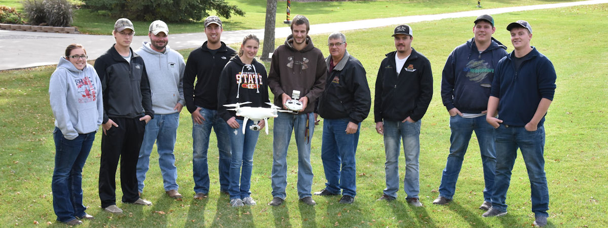 Ag Systems Mgmt students with a camera-equipped drone