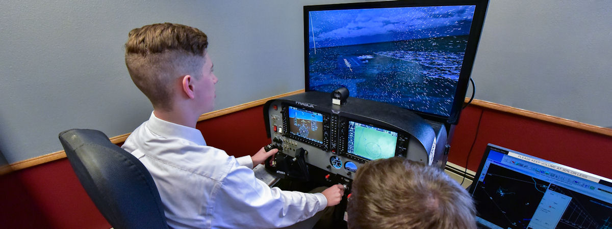 student using an aviation simulator