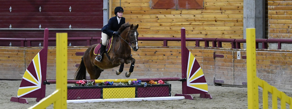 member of the equestrian team riding a horse