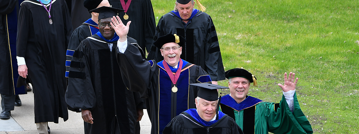 Faculty walking on the Mall to Lysaker Gymnasium for Commencement