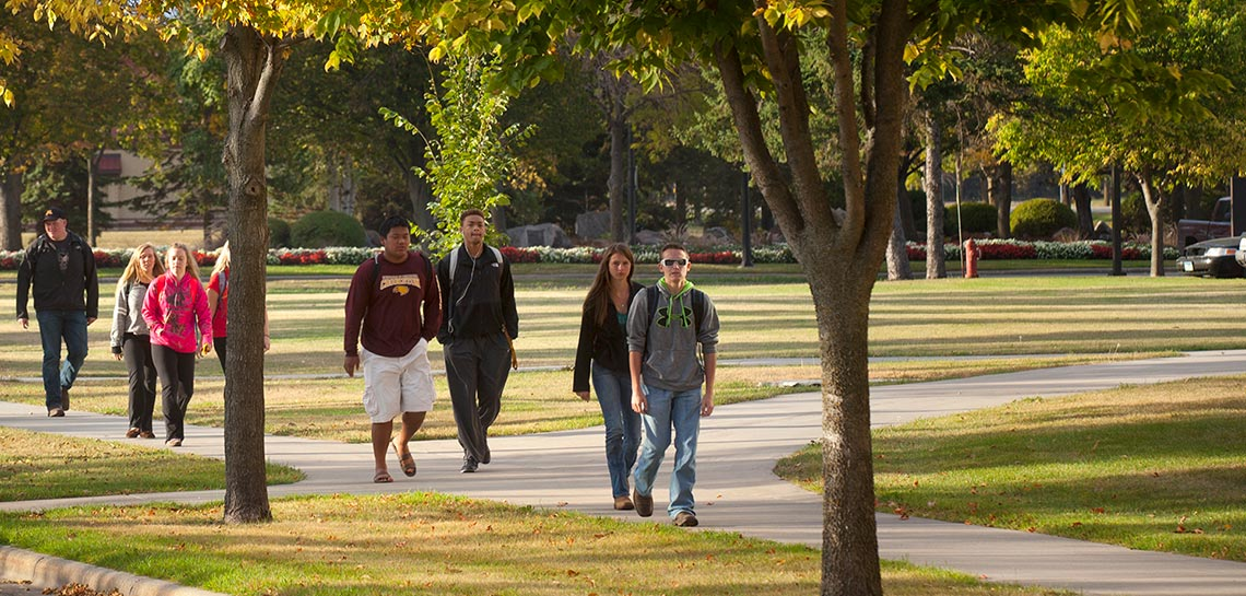 Students walking to class outside Kiehle Building in the Fall