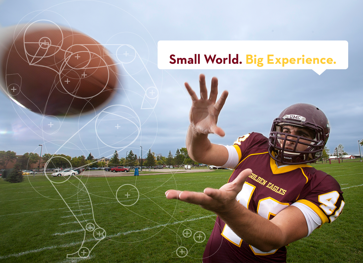 "UMC football player catching at football with tag line ""Small World. Big Experience."""