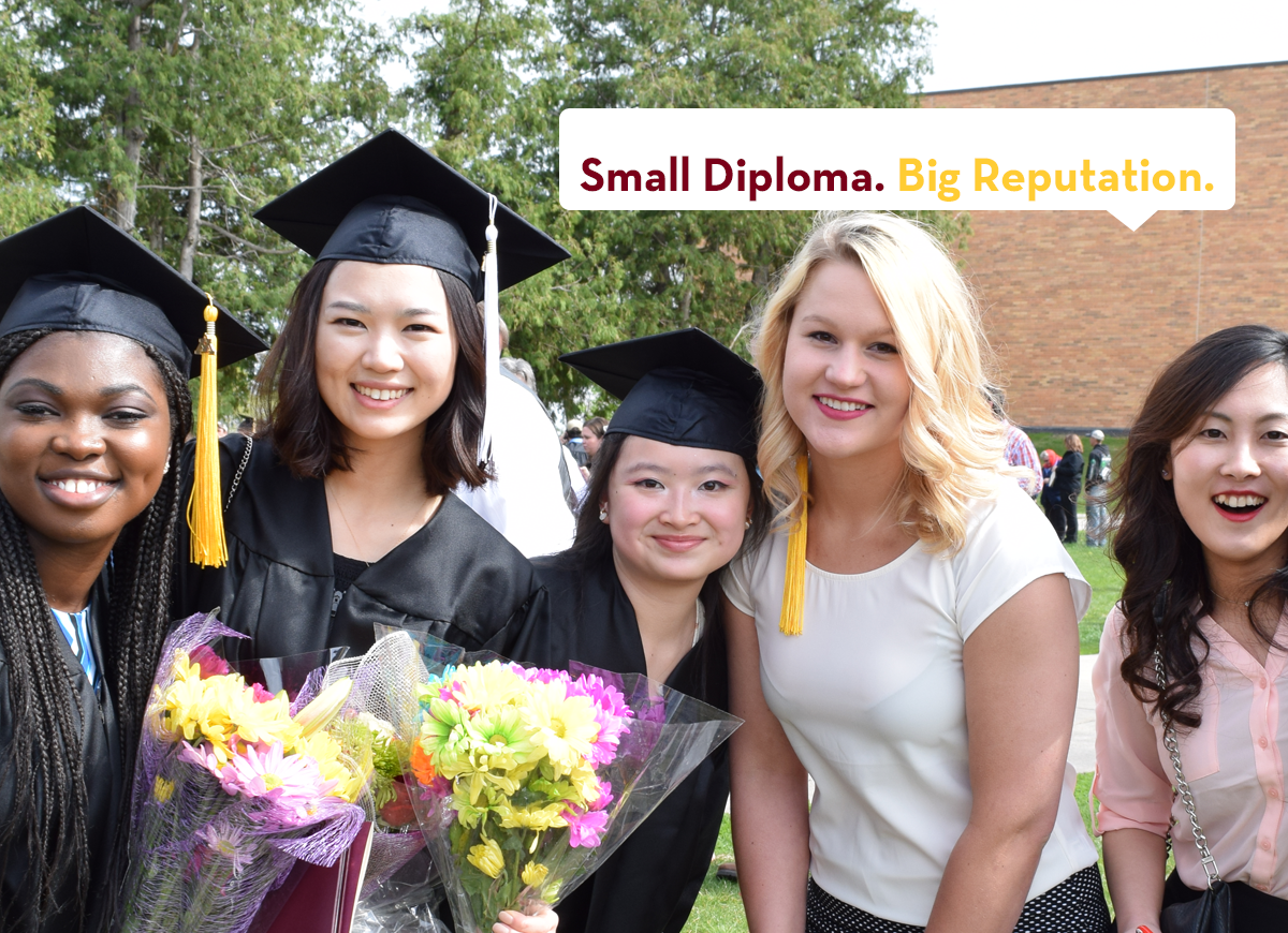 "UMC students at graduation with tag line ""Small Diploma. Big Reputation."""