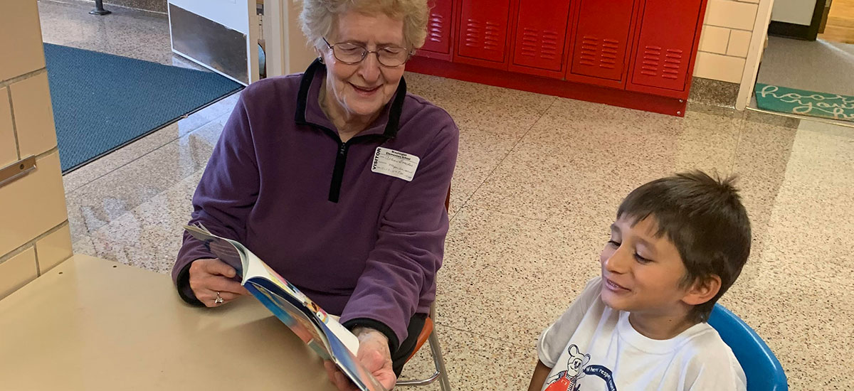 Allean reading with a child at Washington School.