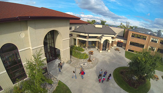 Birds eye view of Sargeant Student Center and Hill Hall with students walking on sidewalks