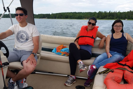 Exchange students enjoying a boat ride