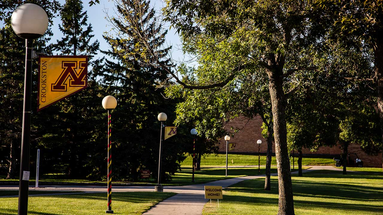 Campus Mall with UM Crookston banners on a warm summery day