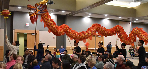 International students parading the Chinese New Year Dragon in Bede Ballroom.