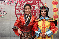 Two women dressed in traditional Chinese apparel.