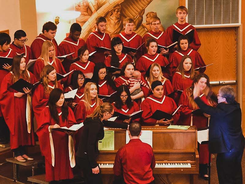 UMC Choir singing during Commencement