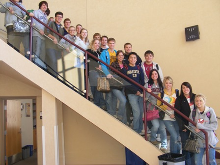 A class of visiting College in the High School students standing on the stairway of Kiehle Rotunda.