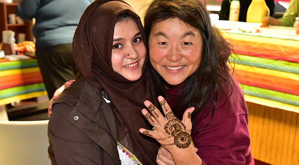 Rae French with henna ink design from one of UMC's female International students.