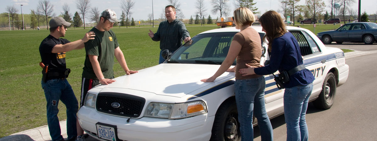 Teacher teaching students about pulling people over