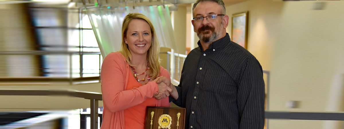 2016 Distinguished Professional and Administrative Award was Amber Bailey, presented by Andrew Svec