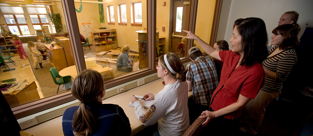 Early Childhood and Elementary Education students using the lab at the Early Childhood Development Center, observing children without interruption.
