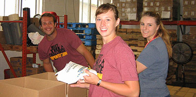 Students packing food boxes at North Country Food Bank.