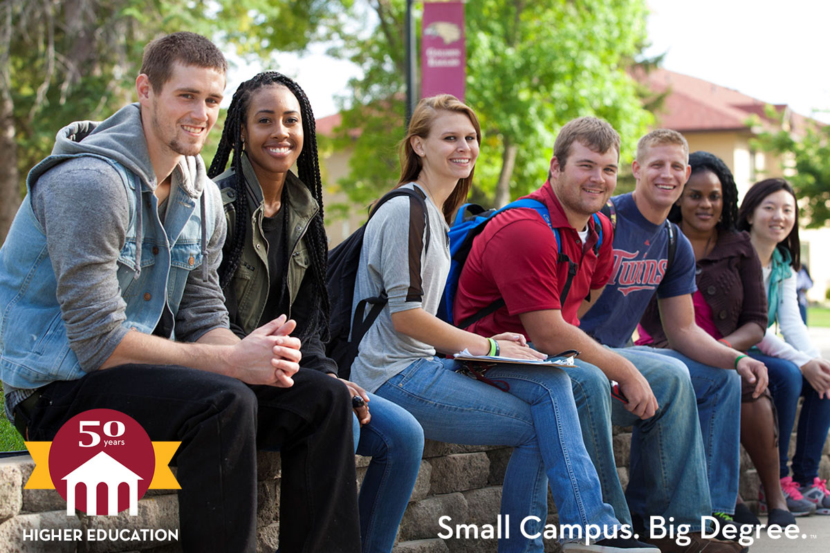 University of Minnesota Crookston - Small Campus. Big Degree. Celebrating 50 years in higher education! (Photo: Diverse group of students sitting along the campus mall)
