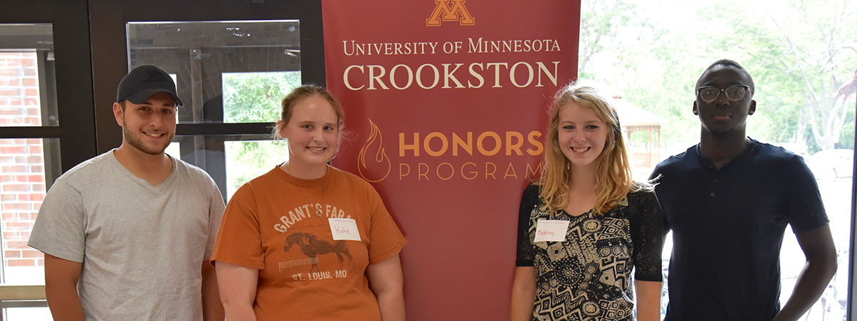 UMC Honors Program students standing in front of an Honors Program banner.