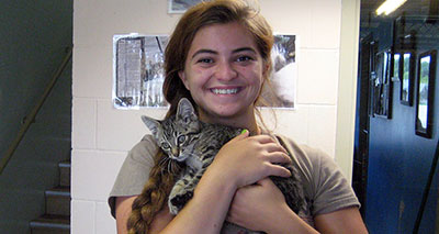 Student holding a kitten at the Polk County Humane Society.