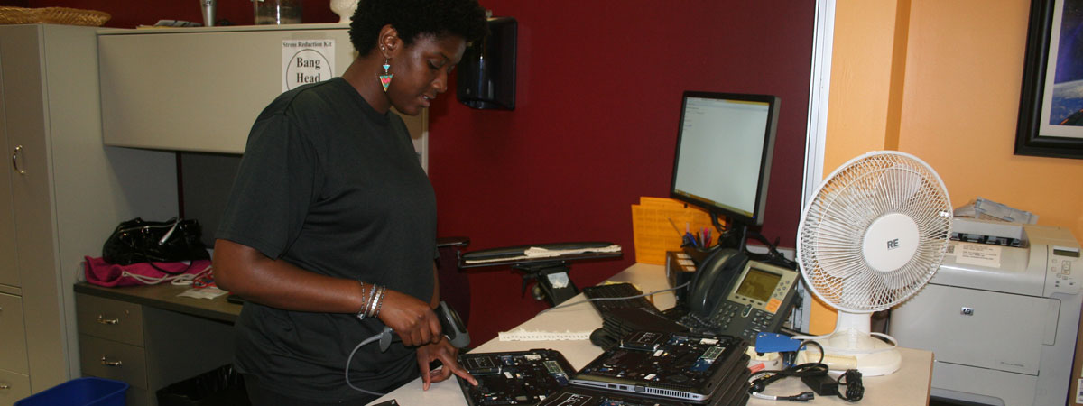 A student worker working on computers