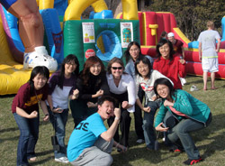 A group of students in front of a bouncy house