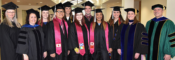 International students during graduation with their faculty advisors.