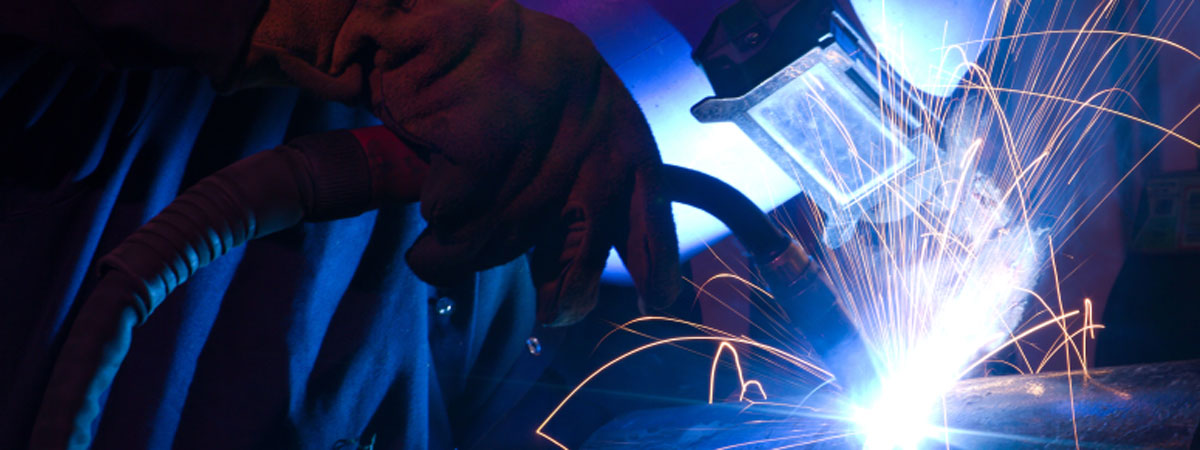 A person is welding on a project