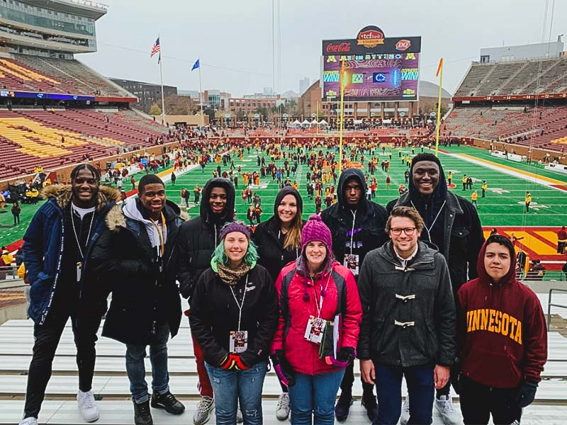 Group of Crookston students at a Golden Gopher football game