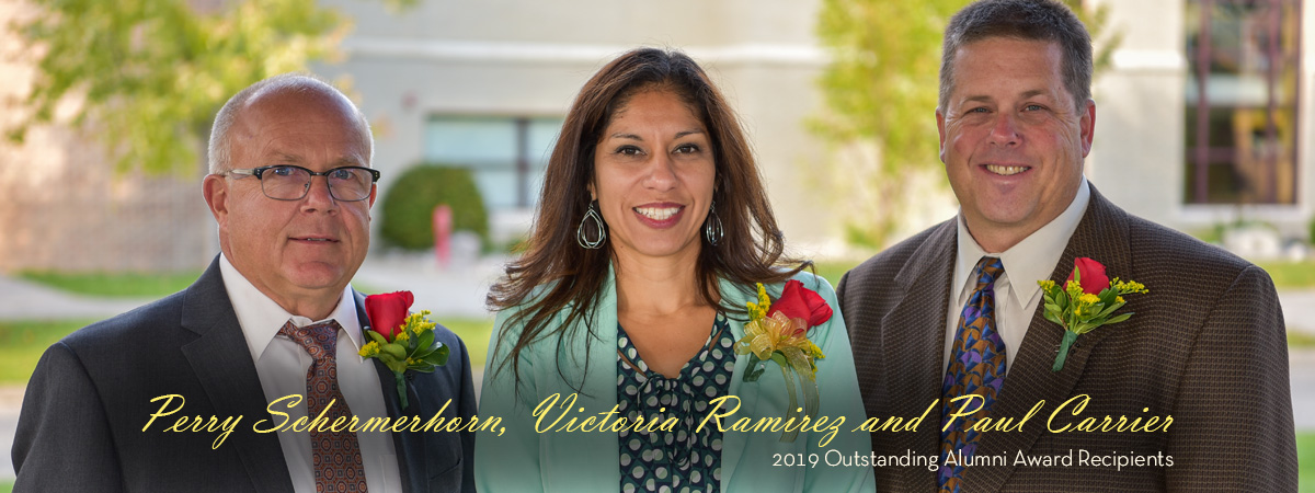 Photo of Outstanding Alumni honorees Perry Schermerhorn 1979 and 2017, Victoria Ramirez 2002, and Paul Carrier 1987 and 1997