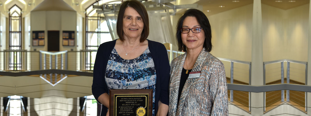 Sharon Stewart, 2017 award recipient, and Soo-Yin Lim-Thompson, presenter.