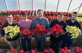 Students with poinsettias