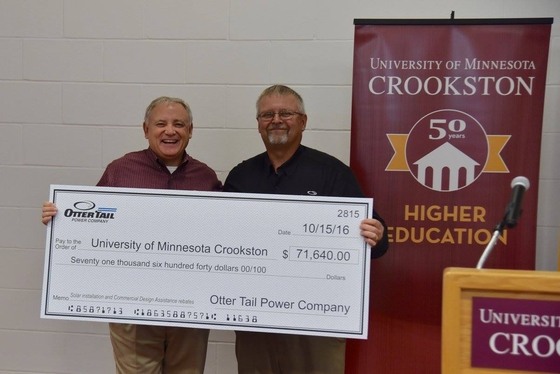 Chancellor Fred Wood and Otter Tail Power Company's Ken Johnson with rebate check