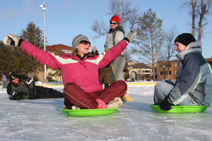 Students on sleds during Winter Fun Day