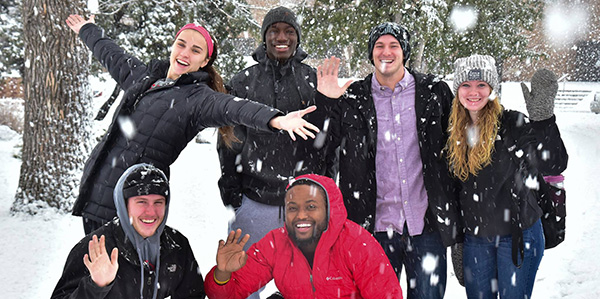 Several UMC students enjoying the big snowflakes during winter.