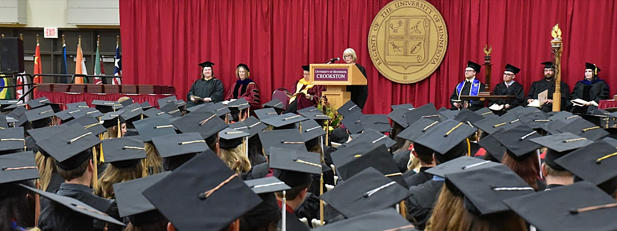 Photo of UMC Commencement 2018 - students sitting listening to speaker Peggy Hilton