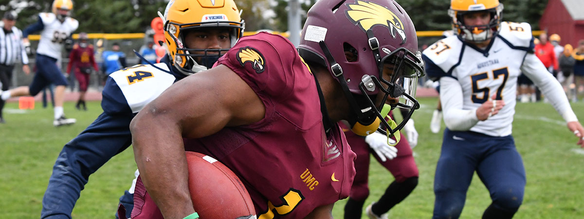 University of Minnesota Crookston Golden Eagle Football Player carrying the ball during the 2018 Homecoming Game vs Augustana