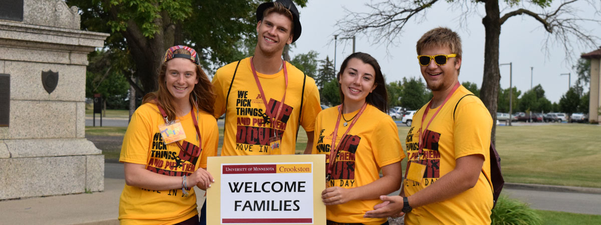 UMC SOS leaders welcoming families as they drive in during orientation.