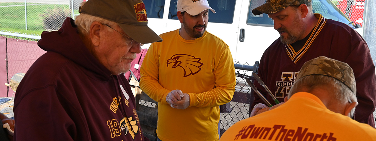 UMC Staff serving during the Homecoming 2019 Teambacker Tailgate
