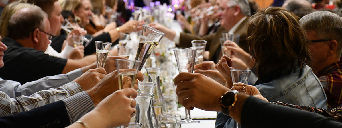 Farm to Table guests at the 2018 event raise their glasses high for a cheers!
