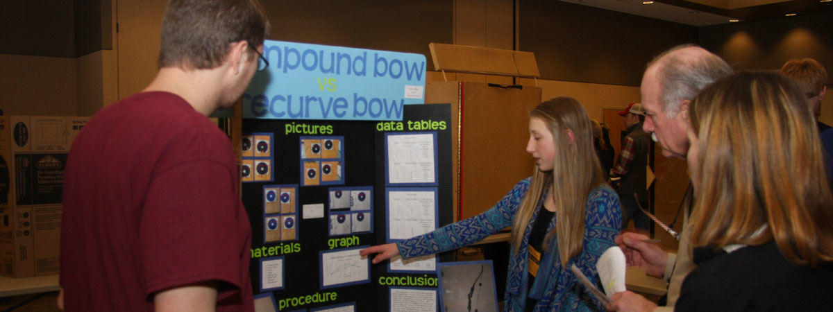 Student poster presentation on archery.