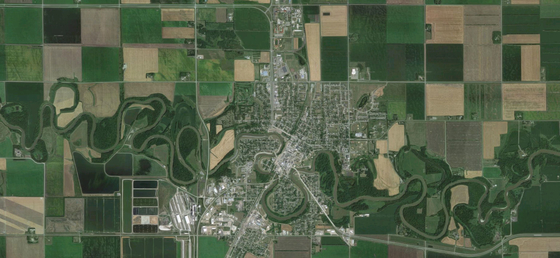 Crookston as seen from above showing streets and the Red Lake River