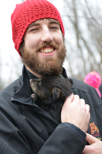 student holding a bear cub