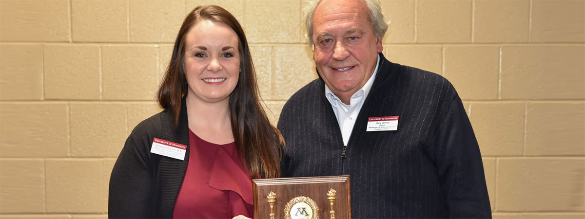 2018 Distinguished Staff Award recipient Kelsey Torgerson with presenter Gary Willhite