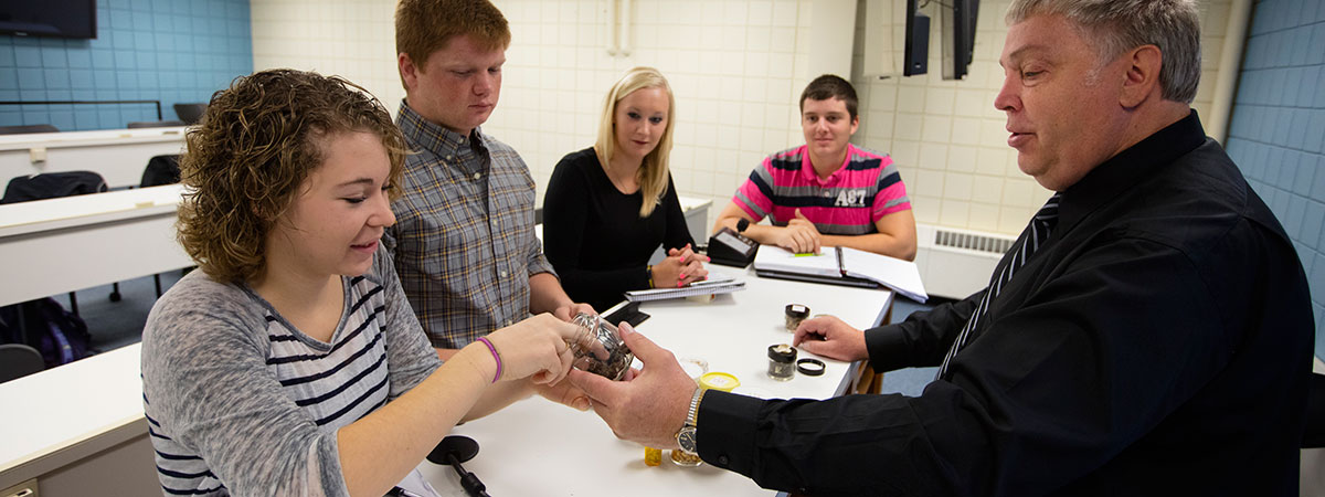 Students learning hands on with professor