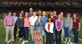 UMC Alumni at an event at TCF Stadium